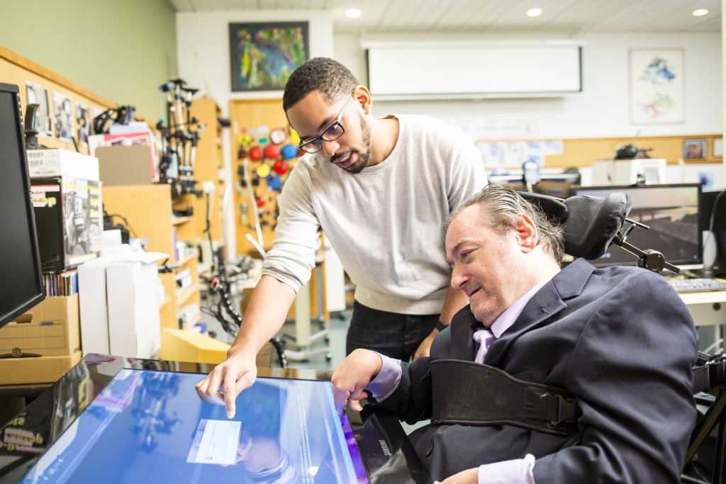 iSchool Ph.D. student Martez Mott works with participant Ken Frye to test touch-enabled devices for people with motor impairments and for people under the effects of situational impairments